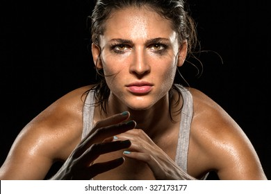 MMA fighter boxer athlete intense focus eyes wrestler strong confident woman close up
