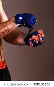 mma fighter is getting ready on gray background