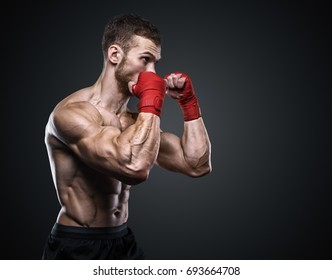 MMA Fighter Preparing Bandages For Training.
