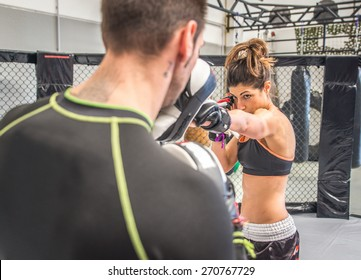 mma fighting training in the cage. concept about sport, fitness,mma,kickboxing,training, and people
