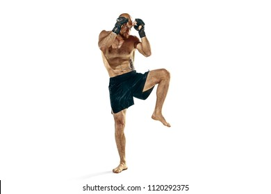 MMA. The professional boxer boxing isolated on white studio background. Fit muscular caucasian athlete fighting. Sport, competition, excitement and human emotions concept