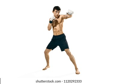 MMA. The professional boxer isolated on white studio background. Fit muscular caucasian athlete fighting. Sport, competition, excitement and human emotions concept