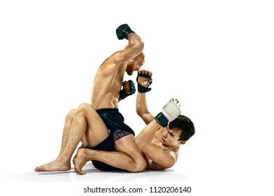 MMA. Two professional boxers boxing isolated on white studio background. Couple of fit muscular caucasian athletes fighting. Sport, competition, excitement and human emotions concept