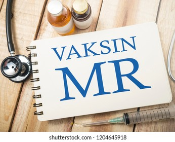 "MMR MR Measles Mumps Rubella Vaccine, healthcare and medical concept, top view of doctor working desk (word ""Vaksin"" means Vaccine in Indonesian)"