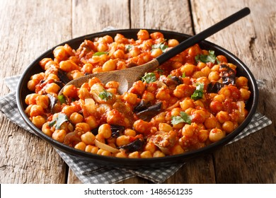 mnazaleh chickpeas with eggplant in tomato sauce close-up on a plate on the table. horizontal