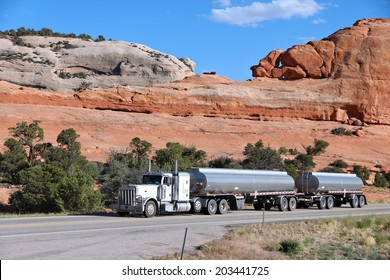 MOAB, UNITED STATES - JUNE 23, 2013: Peterbilt truck drives a scenic road in Utah, USA. Peterbilt is one of most famous American truck manufacturers. It was founded in 1939.
