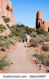 Moab, UT, USA - April 22, 2017: Hikers walking on the scenic Devils Garden trail