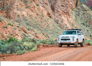 Moab , UT, USA - May 6, 2018:  Toyota 4runner SUV (2016 trail edition, stock vehicle without any off road modifacations)) on a desert canyon road.