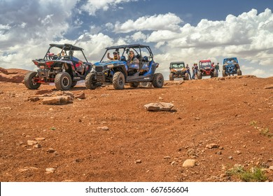 MOAB, UT, USA - MAY 7, 2017: Group of ATV riders enjoys a break on a summit of the Hurrah Pass on the popular Chicken Corner trail in the Moab area.