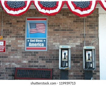 MOAB - UTAH, AUG 5: Public telephones with american flags, August 5, 2005 in Moab, Utah. Payphone revenues are sharply declining in many places