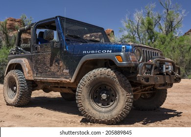 Moab, Utah - May 15, 2014: Muddy jeep on a back country four wheel drive trail in Utah's Canyonlands National Park.