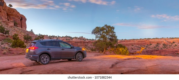 MOAB, UTAH - OCTOBER 12, 2017: A Toyota Rav4 perched on flat rock above the canyon.