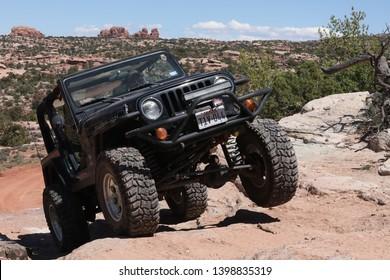Moab Utah , USA , April , 23, 2019: Black Rubicon Jeep on the Metal Masher off road Jeep trail .