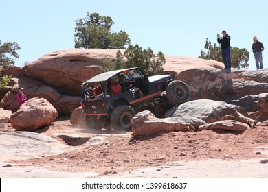 Moab, Utah, USA, April, 23,2019: Buggy climbing an obstacle on the Metal Masher 4x4 off road Jeep trail.