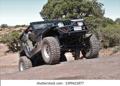 Moab, Utah, USA, April 23,2019 : Black Rubicon Jeep on the Metal Masher 4x4 off road Jeep trail.