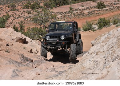Moab, Utah, USA, April 23,2019 : Black Rubicon Jeep on the Metal Masher 4x4 off road Jeep trail.