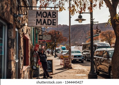 MOAB, UTAH, USA - November 8, 2018 : A tourist under a Moab Made sign.