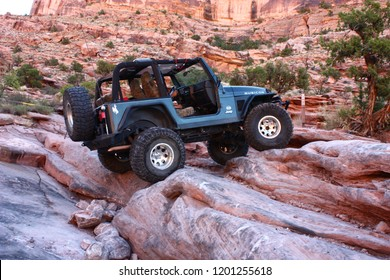 Moab, Utah, USA, September 17,2018:Black Rubicon Jeep on Moab Rim 4x4 off road Jeep trail.
