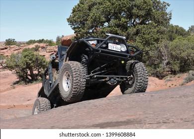 Moab Utah, USA,April,23,2019 : Black Rubicon Jeep on Metal Masher off road 4x4 Jeep trail.
