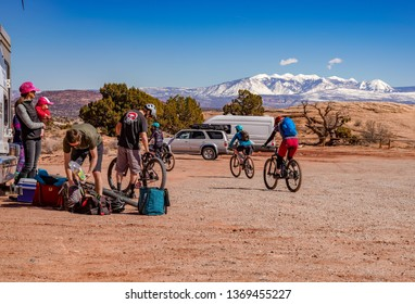 Moab, Utah/united States-3/16/19 -     A group of people gearing up for a long day of mountain biking near Moab, Utah
