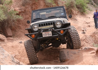 Moab ,Utah,USA,April,20,2019 : Black Rubicon Jeep on Kane Creek 4x4 off road Jeep trail during Easter Safari.