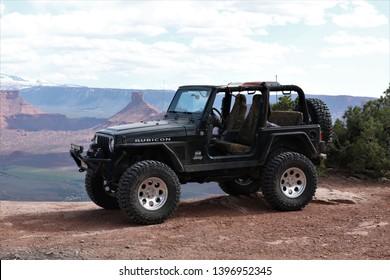 Moab, Utah,USA,April,21,2019 : Black Rubicon Jeep at Dome Plateau overlook.