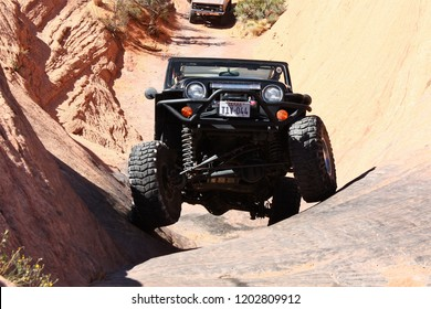Moab, Utah,USA,September 16,2018: Black Rubicon Jeep coming up Hell's Gate on Hell's Revenge 4x4 off road Jeep trail.