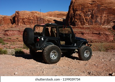 Moab, Utah,USA,September 17,2018: Black Rubicon Jeep on the off road 4x4 Cliffhanger Jeep trail.