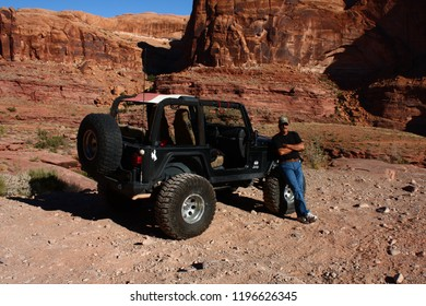 Moab, Utah,USA,September 17,2018:Black Rubicon Jeep with driver  in front of the Cliffhanger 4x4  off road jeep trail.