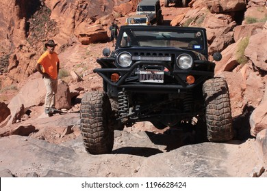 Moab, Utah,USA,September 17,2018:Black Rubicon Jeep on the Cliffhanger 4x4  off road jeep trail.