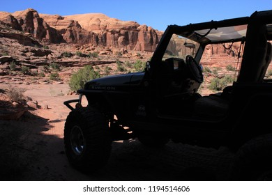 Moab, Utah,USA,September 17,2018:Silhouette of a black Rubicon Jeep with a mountain in the background on the Cliffhanger off road jeep trail.
