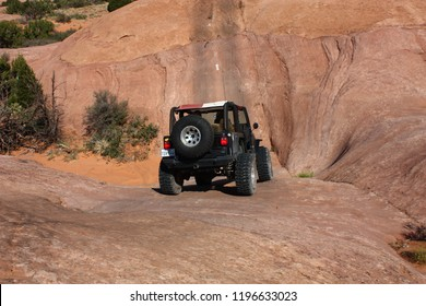 Moab, Utah,USA,September 20,2018:Black Rubicon Jeep on the Golden Spike  4x4  off road jeep trail on the Launching Pad.