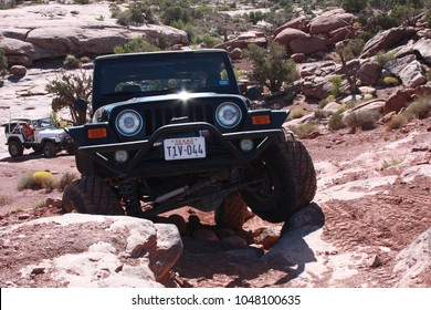 Moab, Utah,USA,September,15,2017:Black Jeep Rubicon articulating  on The Cliffhanger 4x4 off road trail.