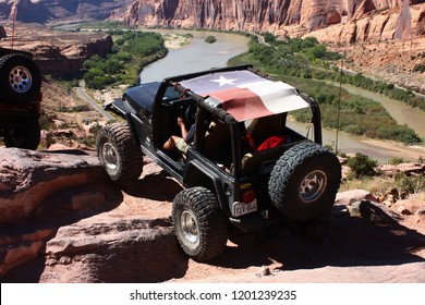 Moab, Utah,USA,September,17,2018 : Black Rubicon Jeep on Moab Rim 4x4 off road jeep trail.