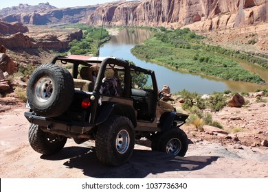 Moab,Utah,USA,September,13,2017,Rubicon Jeep driving the Moab Rim trail overlooking the Colorado River.