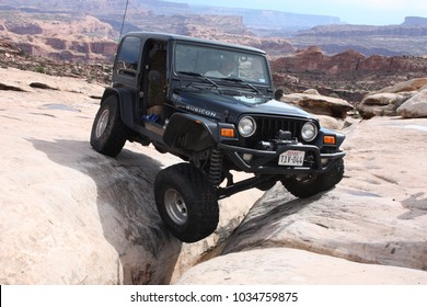 Moab,Utah,USA,September,14,2017:Jeep Rubicon articulating on  the Golden Crack obstacle on the Golden Spike 4x4 off road trail.