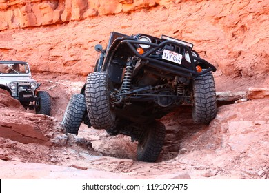 Moab,Utah,USA,September,16,2018,Black Rubicon Jeep on the 3D trail doing the Pickle obstacle.