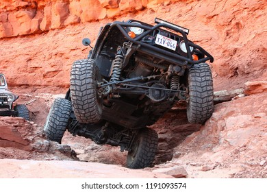 Moab,Utah,USA,September,16,2018,Black Rubicon Jeep on the 4x4 off road  3Dtrail doing the Pickle obstacle.