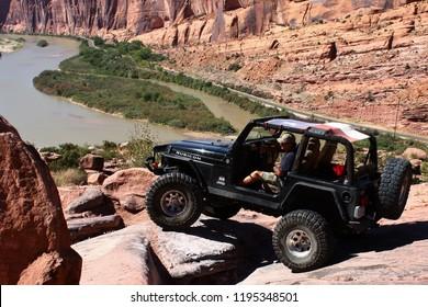 Moab,Utah,USA,September17,2018:black Rubicon Jeep on Moab Rim off road 4x4 jeep trail.