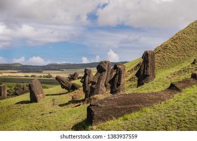 Moai in Rano Raraku, easter island (pascua), blue sky and clouds during sunrise. Moai workshop quarry, rapanui. Chile