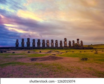 Moai statues with colorful clouds on Easter Island on sunset. Ahu Tongariki against Blue Sky, Chile, South America
