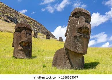 Moai statues in the Rano Raraku Volcano in Easter Island, Rapa Nui National Park, Chile - Shutterstock ID 1668863077