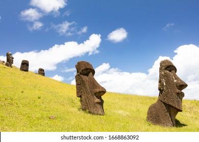 Moai statues in the Rano Raraku Volcano in Easter Island, Rapa Nui National Park, Chile - Shutterstock ID 1668863092