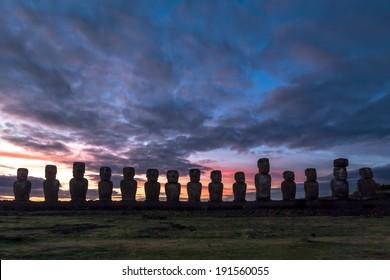 Moais at Ahu Tongariki against a colorful sky at sunrise, Easter Island (Rapa Nui), Chile