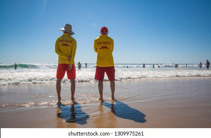 MOANA BEACH, ADELAIDE, SOUTH AUSTRALIA, JANUARY 2019; Two surf lifesavers on patrol