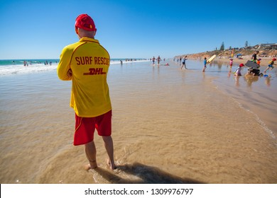 MOANA BEACH, ADELAIDE, SOUTH AUSTRALIA, JANUARY 2019; A surf life saver on patrol