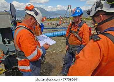 MOANA, NEW ZEALAND, OCTOBER 27, 2017: The safety officer conducts a safety meeting at an abandoned oil well before sending workers into a  confined space.