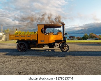 Moana Village , October 2017, South Island of New Zealand. Early 20th century vintage yellow Steam Truck driving on a road.