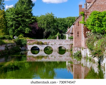 The moat at Kentwell Hall, a Tudor period manor house, in summer 2017