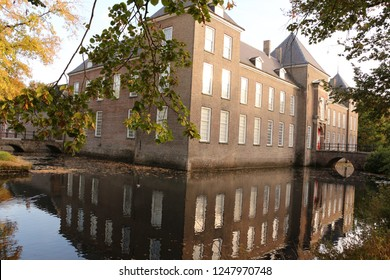 Moat at a moated castle in Noord Brabant in Holland